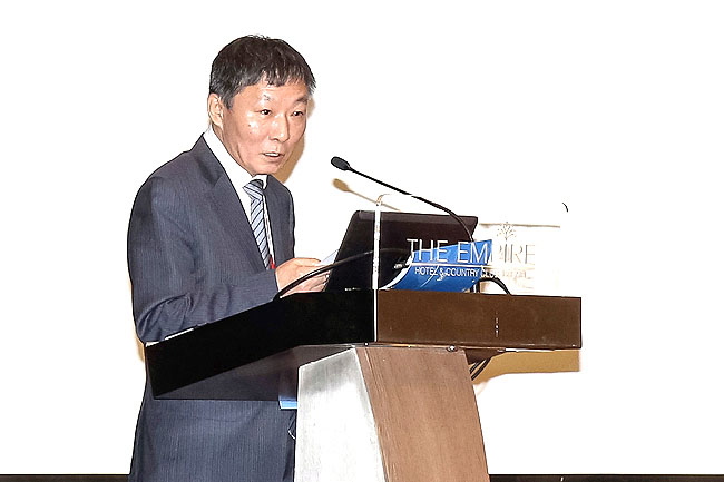 Chairman of Guangxi Beibu Gulf International Port Co Ltd, Mr Zhou Xiaoxi speaks at the International Food and Biotech Investment Conference.