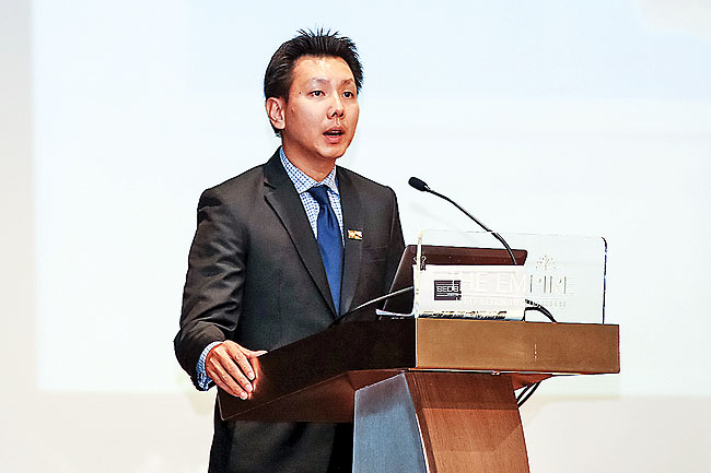 Assistant CEO of Brunei Economic Development Board (BEDB), Desmond Lim speaks at the conference.